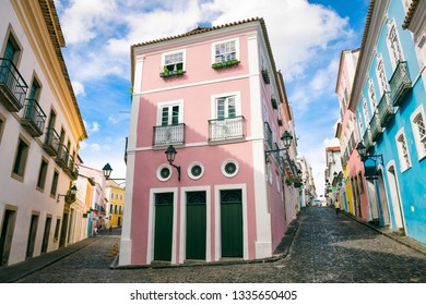 Scenic daytime view of narrow cobblestone streets lined with colorful colonial architecture of the historic tourist center of Pelourinho, in Salvador da Bahia, Brazil