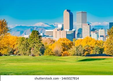 Scenic of Denver Colorado skyline. City Park and Rocky Mountains. Located in Denver, Colorado, USA.