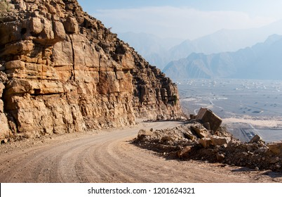 Scenic desert road surrounded by rocks in Musandam Oman