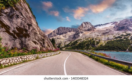 Scenic drive near Fedaia lake and Marmolada mountain with colorful sky during sunset. Gran Poz location, Trentino-Alto Adige. Italy, Amazing nature Landscape