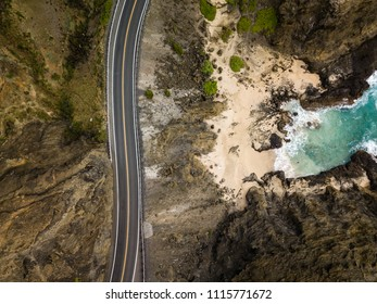 Scenic drone aerial seascape view of Halona Cove coastline and highway on Oahu, Hawaii, USA.