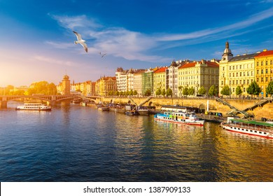 Scenic embankment in Prague city; Historical center of Prague, buildings and landmarks of old town, Prague, Czech Republic. Embankment of the Vltava river in Prague, the capital of Czechia.