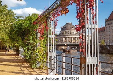 Scenic embankment of the Spree near Monbijou bridge in autumn, Berlin, Germany