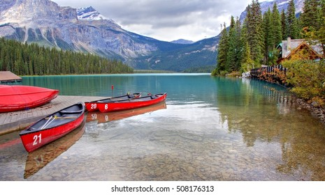 The scenic Emerald lake at Canada, Alberta. The green blue color of the lake looks amazing against the mountains that surrounding the lake .Tourist are taking a canoe to explore and relax