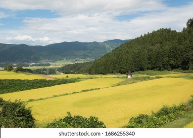 Scenic and epic landscape viewfrom the paddy fields of mountain range and ski pistes through the sky and the clouds in Japan.
