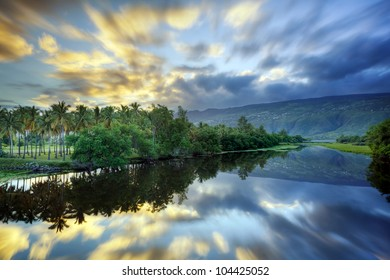 Scenic Etang Saint Paul river at dawn, Reunion Island.