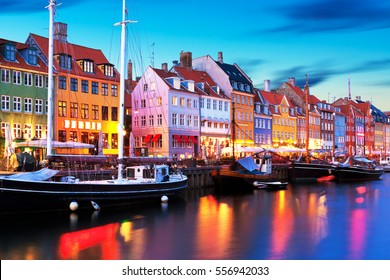 Scenic evening panorama of famous Nyhavn pier architecture in the Old Town of Copenhagen, Denmark