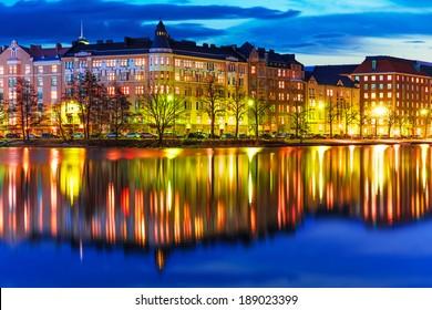 Scenic evening panorama of sea pier illuminated architecture in Hakaniemi district in Helsinki, Finland