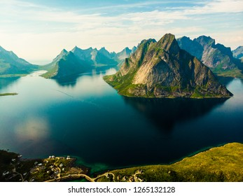 Scenic fjord landscape with Reine village, coast nature with sharp high mountain peaks, Lofoten islands North Norway. Travel destination.