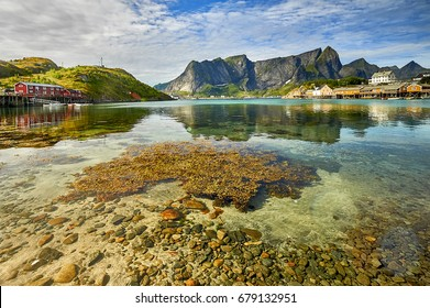Scenic fjord on Lofoten islands with typical red fishing hut, Sakrisoy, Norway
