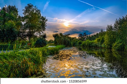 Scenic forest river reflection at sunset - Shutterstock ID 1520856599