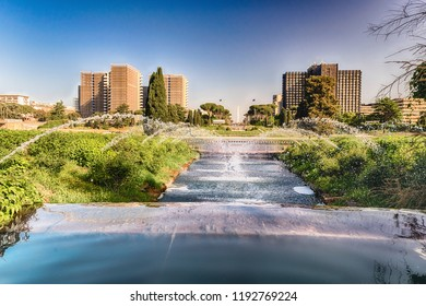 Scenic fountain near the EUR artificial lake, modern district in the south of Rome, Italy
