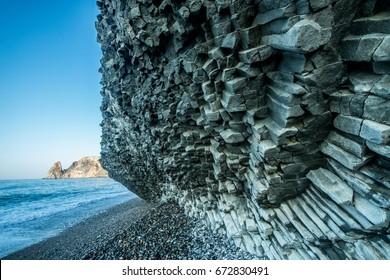 Scenic graphite rock at the seashore