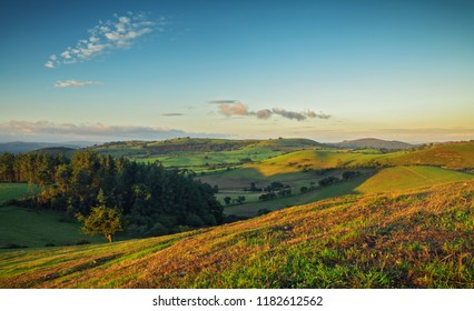 Scenic green fields of British countryside at Sunrise. Shropshire Hills in United Kingdom