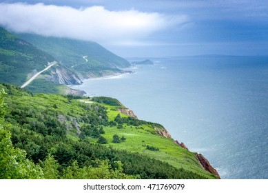 scenic  green lands and road of Cape Breton, Highlands National Park, Nova Scotia, Canada