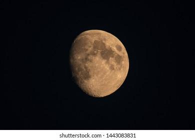 Scenic growing up moon on dark night sky