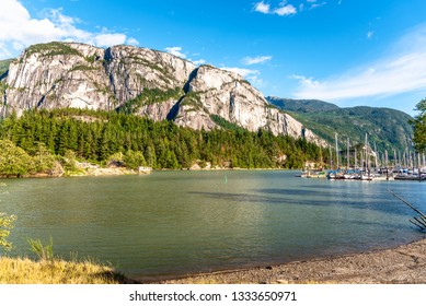 Scenic Harbour with Towering Mountains in Background on a Sunny Summer Evening. Squamish, BC, Canada.
