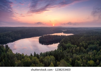 Scenic high angle landscape with sunrise, forest and lake at autumn morning in nature reserve, Finland