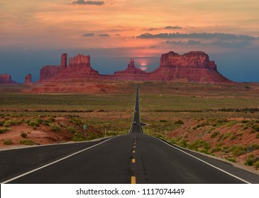 Scenic highway in Monument Valley Tribal Park in Arizona-Utah border, U.S.A. at sunset.