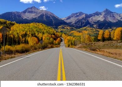 Scenic highway vista in southwest Colorado during fall color in the high country with changing aspen trees