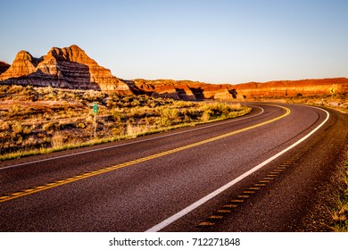 Scenic highway winds through red sandstone spires in Red Canyon, near Bryce National Park at dusk
