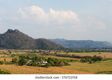 Scenic hillside homes in rural areas of Thailand, which is agriculture, deforestation and drought.