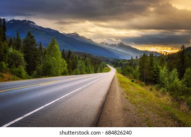 Scenic Icefields Pkwy in Banff National Park at sunset. It travels through Banff and Jasper National Parks and offers spectacular views of the Rocky mountains.
