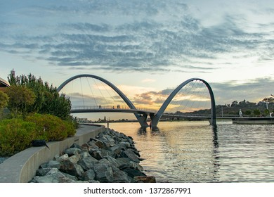 Scenic and iconic Elizabeth Quay arched pedestrian bridge at sunset in Perth Western Australia.