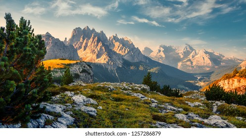 Scenic image at alps during sunrise. Incredible summer landscape. Panorama of Dolomiti, Tre Cime di Lavaredo. Drei Zinnen. The most beautiful attraction of Dolomites Alps. Italy. Awesome Nature.