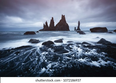 "Scenic image of beautiful nature landscape. Reynisdrangar basalt rocks or ""Troll toes"". Location Reynisfjara Beach, Atlantic ocean near Vik, Iceland (Sudurland), Europe. Discover the beauty of earth."