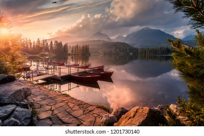Scenic image of Fairytale lake during sunset. The sunrise over a lake in park High Tatras. Strbske Pleso, Slovakia. Wonderful Autumn landscape. Picturesque view of nature. Amazing natural Background
