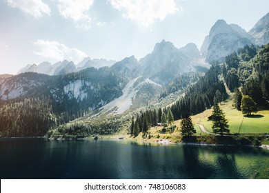 Scenic image of great alpine lake Vorderer Gosausee. Salzkammergut is a famous resort area located in the Gosau Valley in Upper Austria. Dachstein glacier. Explore the beauty of earth. Vintage tone.