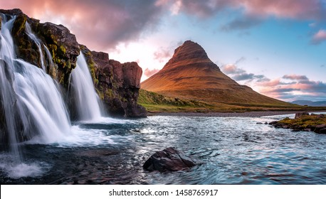Scenic image of Iceland. Great view on famouse Mount Kirkjufell With Kirkjufell waterfall during sunset. Wonderful Nature landscape. Popular Travel destinations. Picture of wild area.