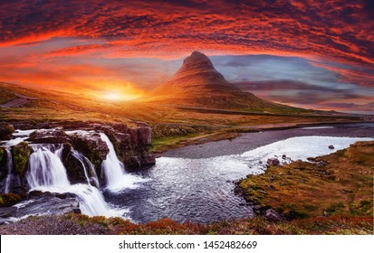 Scenic image of Iceland. Incredible Nature scenery during sunset. Great view on famous Mount Kirkjufell with Colorful, dramatic sky.  Best famous travel locations.