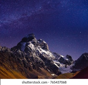 Scenic image of night sky over the peak Ushba. Location Mestia, Upper Svaneti, country Georgia, Europe. Main Caucasian ridge. Astrophotography. Adventure vacations. Explore the beauty of earth.