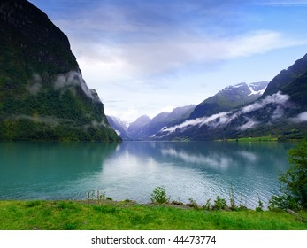 Scenic image of a typical norwegian fjord near Hellesylt, a village situated in the Geirangerfjord.