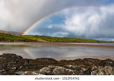 Scenic irish beach landscape rainbow reflection, the wild atlantic way on west coast of Ireland