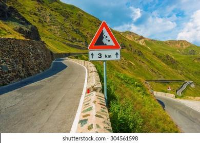 Scenic Italian Stelvio Pass Road Falling Rock Sign.