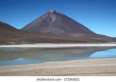 "Scenic lagoon in Bolivia Laguna Verde (Spanish ""green lake"") is a salt lake located on the Chilean border at the foot of the volcano Licancabur in Eduardo Avaroa Andean Fauna National Reserve."