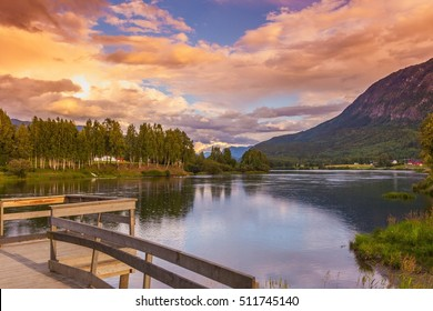 Scenic lake water landscape and sunset sky view among Norway mountains and forest, Europe