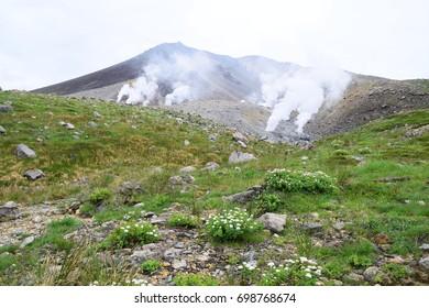 Scenic landscape around Mount Asahidake during summer season. The mountain located in Daisetsuzan National Park, Hokkaido, Japan.