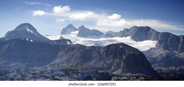 Scenic landscape of the Austrian Alps from the Krippenstein of the Dachstein Mountains range in Obertraun, Austria, Europe