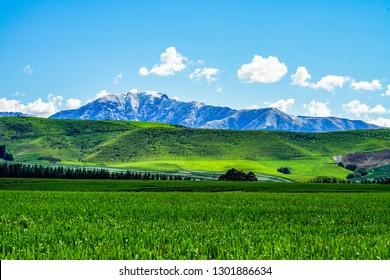 A scenic landscape with beautiful clouds, blue sky and snowcapped mountain close to Lake Opuha, Fairlie, South Island, New Zealand