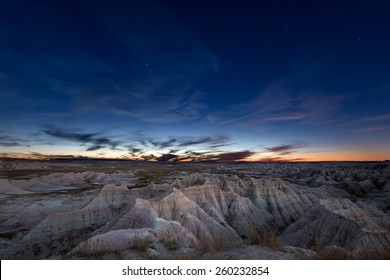 Scenic landscape of the constellation of Ursa Major, or Big Bear, over eroded mountains in the badlands of South Dakota in a starry evening sky
