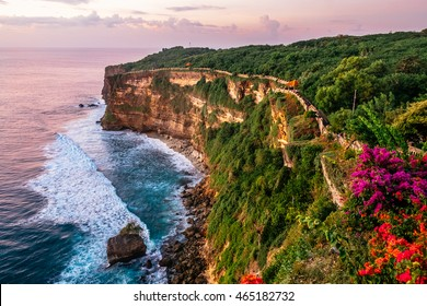 Scenic landscape of fantastic sunset at Uluwatu Bali. Travel Bali, Indonesia. Sunset tranquility in Bali. Sunset at Uluwatu cliff, Indonesia landmark. Explore fantastic sunset in Bali, travel concept