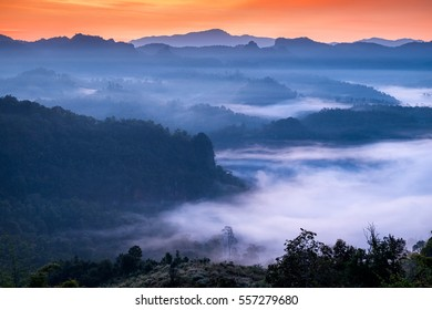 Scenic landscape in foggy valley at dawn,baan jabo,mae hong son,thailand
