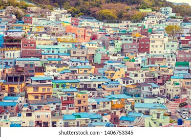 Scenic landscape of Gamcheon Culture Village, colorful and artistic tourist attraction with brightly painted houses on hillside of coastal mountain in Saha District, Busan, South Korea