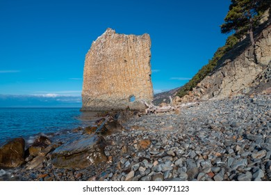 Scenic landscape of a giant wall-like rock formation called in Russian Parus (Sail) on the Black Sea coast, Gelendzhik, Russia. Tourist attraction and landmark. No people