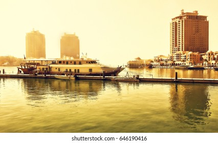 Scenic landscape of hardour with boats and yachts in Doha, Qatar at sunset