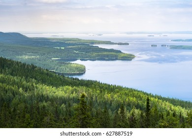 Scenic landscape with lake and lush forest at day time in Koli, national park, Finland